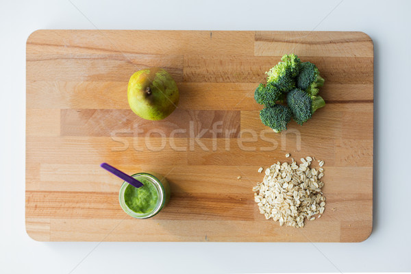 jar with puree or baby food on wooden board Stock photo © dolgachov