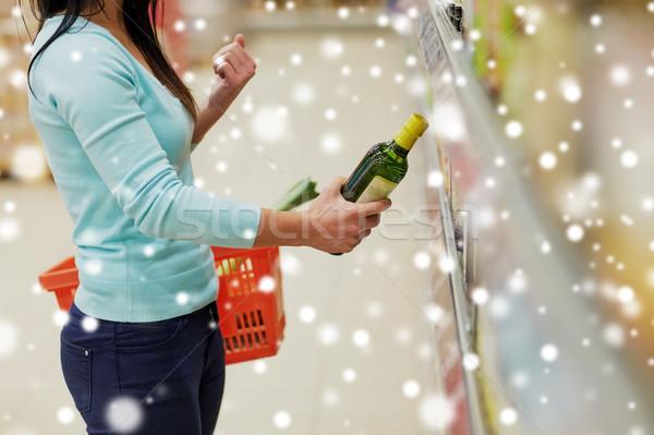 Klant olijfolie supermarkt kruidenier verkoop winkelen Stockfoto © dolgachov