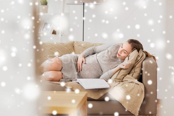 Mutlu hamile kadın uyku kanepe ev gebelik Stok fotoğraf © dolgachov