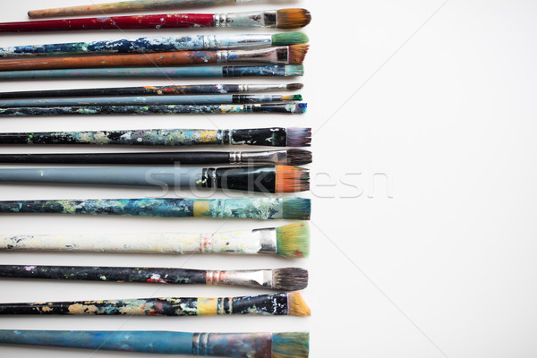 dirty paintbrushes from top Stock photo © dolgachov