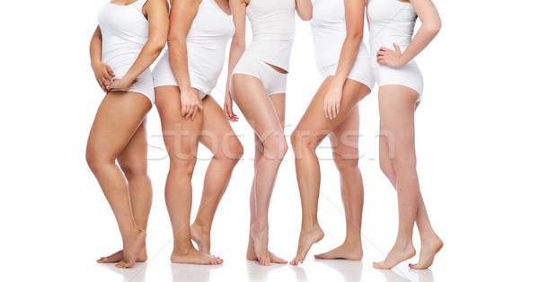 Grupo feliz diverso mulheres branco roupa interior Foto stock © dolgachov