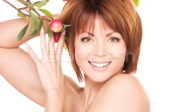 Stock photo: happy woman with apple twig