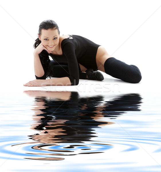 sporty girl in black leotard on white sand Stock photo © dolgachov