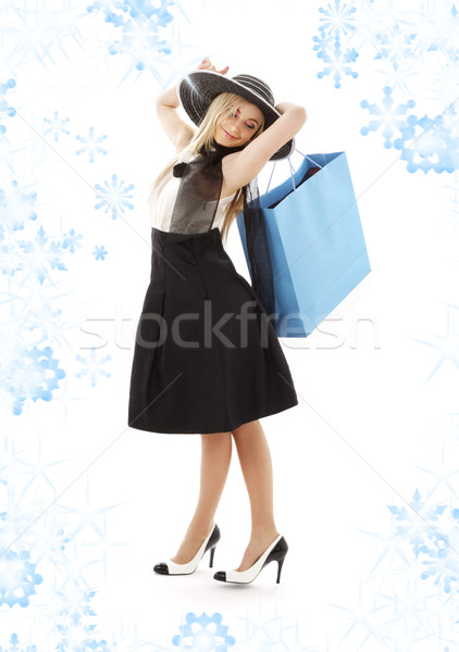 blond in retro hat with blue shopping bag Stock photo © dolgachov