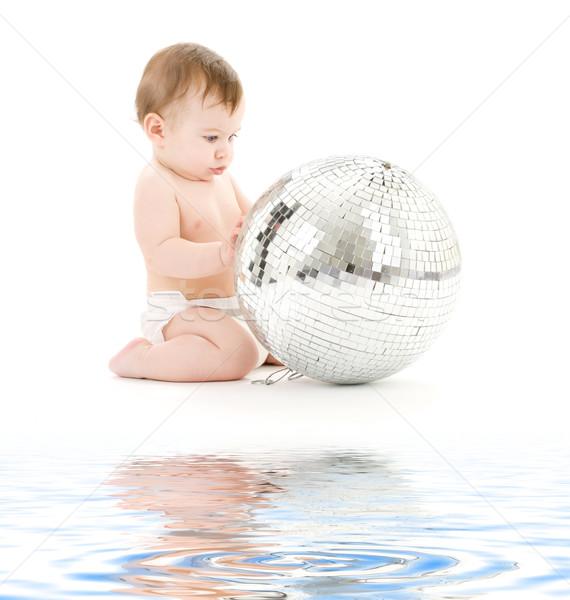 adorable baby boy with big disco ball Stock photo © dolgachov