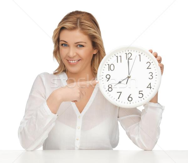 woman with clock Stock photo © dolgachov