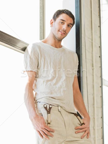 красивый мужчина Постоянный подоконник портрет человека модель Сток-фото © dolgachov