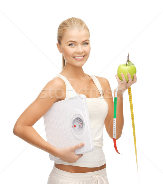 sporty woman with scale, apple and measuring tape Stock photo © dolgachov