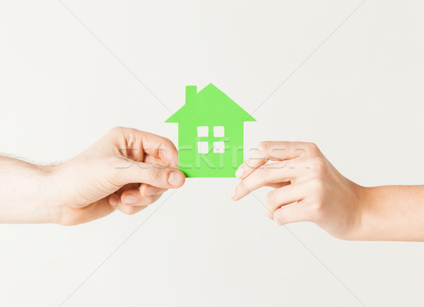 Stock photo: couple hands holding green house