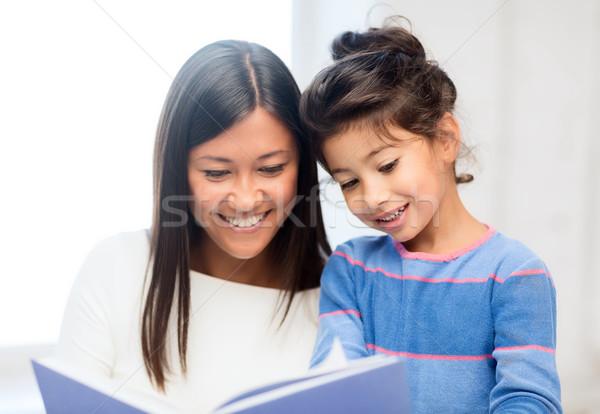 Matka córka książki rodziny dzieci edukacji Zdjęcia stock © dolgachov