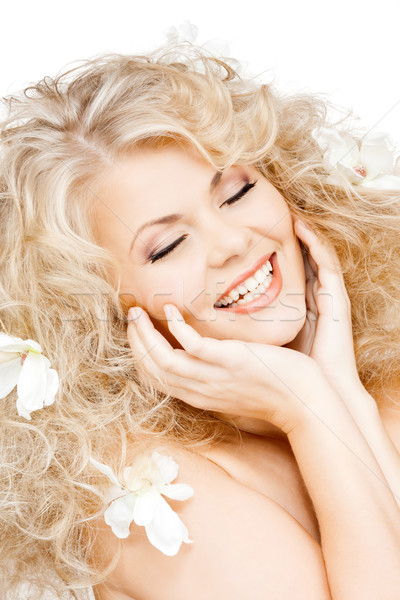 happy woman with flowers in hair Stock photo © dolgachov
