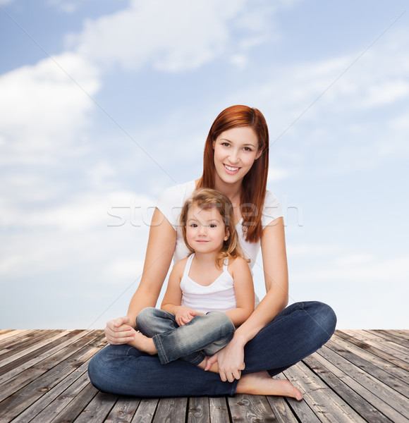 happy mother with adorable little girl Stock photo © dolgachov