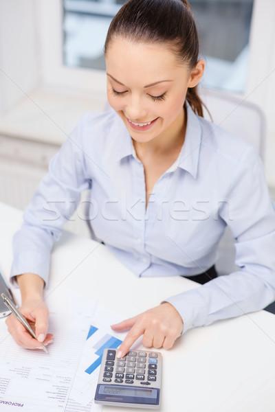 Empresária trabalhando documentos escritório negócio imposto Foto stock © dolgachov