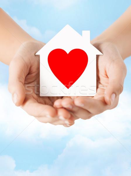 hands holding white paper house Stock photo © dolgachov