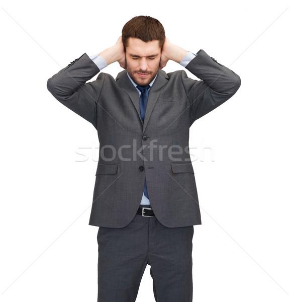 Geërgerd zakenman oren handen kantoor onderwijs Stockfoto © dolgachov