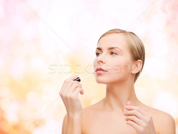 beautiful woman with lipgloss Stock photo © dolgachov