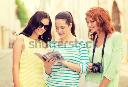 beautiful girls with smartphone in the city Stock photo © dolgachov