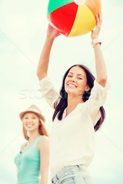 girls playing ball on the beach Stock photo © dolgachov