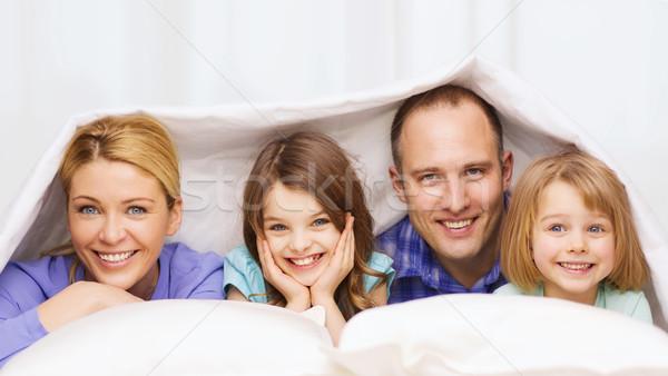 Mutlu aile iki çocuklar battaniye ev aile Stok fotoğraf © dolgachov