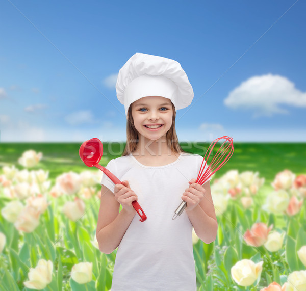 smiling girl in cook hat with ladle and whisk Stock photo © dolgachov