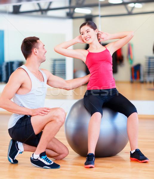 Férfi edző nő labda fitnessz sport Stock fotó © dolgachov