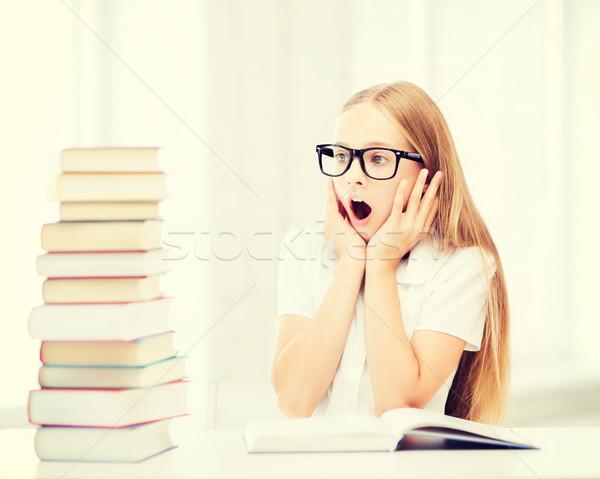 girl with many books at school Stock photo © dolgachov