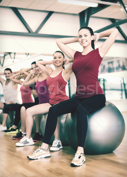 Groupe de gens pilates classe fitness sport Photo stock © dolgachov