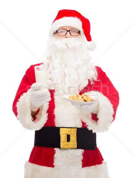 Papá noel vidrio leche cookies Navidad vacaciones Foto stock © dolgachov