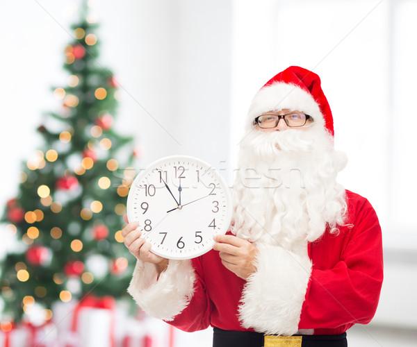 Hombre traje papá noel reloj Navidad vacaciones Foto stock © dolgachov