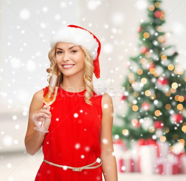 Femme robe rouge verre champagne fête boissons Photo stock © dolgachov
