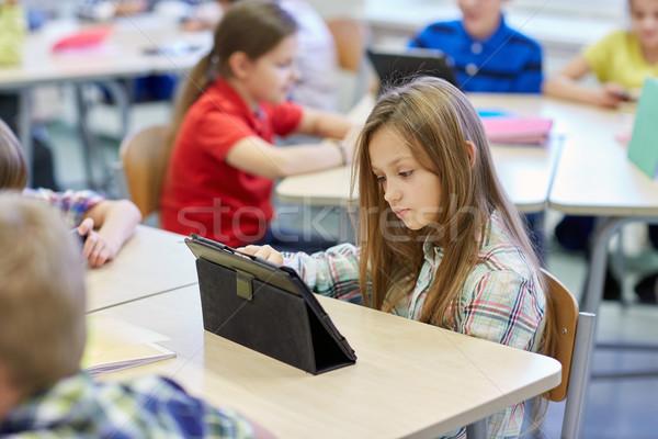 Stock fotó: Iskola · gyerekek · táblagép · osztályterem · oktatás · általános · iskola