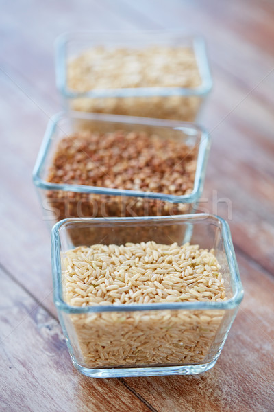 close up of grain in glass bowls on wooden table Stock photo © dolgachov