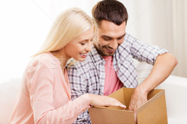 happy couple with parcel box at home Stock photo © dolgachov