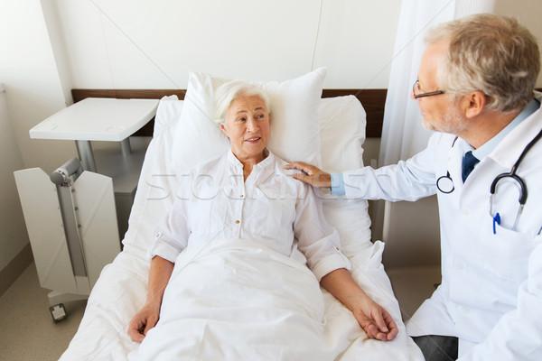doctor visiting senior woman at hospital ward Stock photo © dolgachov