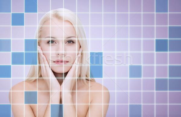beautiful young woman touching face Stock photo © dolgachov