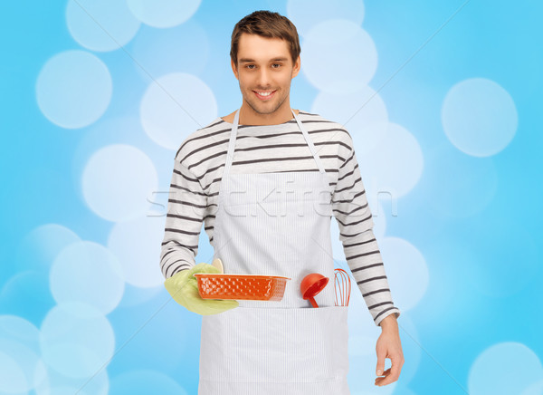 happy man or cook with baking and kitchenware Stock photo © dolgachov