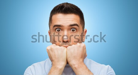 scared man shouting Stock photo © dolgachov