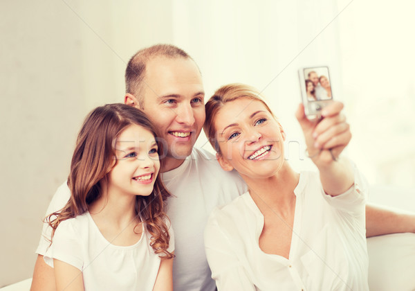 happy family with little girl making self portrait Stock photo © dolgachov