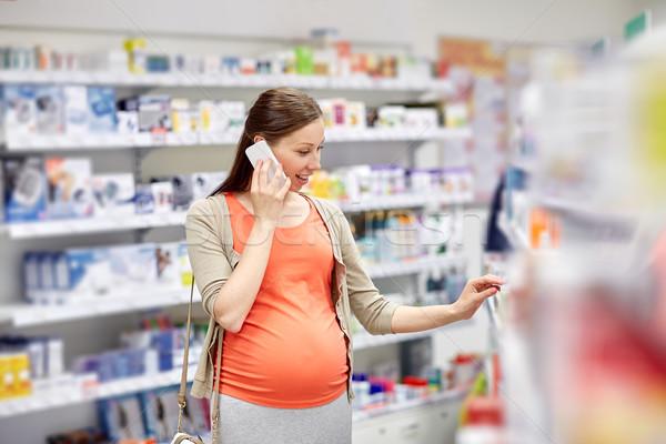 Photo stock: Heureux · femme · enceinte · smartphone · pharmacie · grossesse · médecine