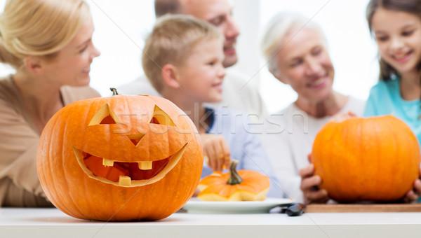 helloween pumpkin lantern over happy family Stock photo © dolgachov