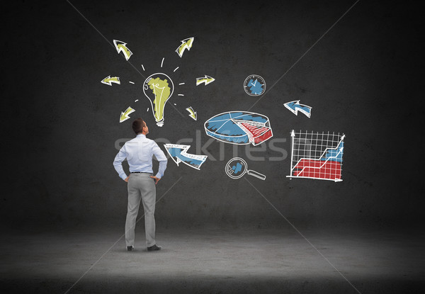 businessman looking at business idea scheme Stock photo © dolgachov