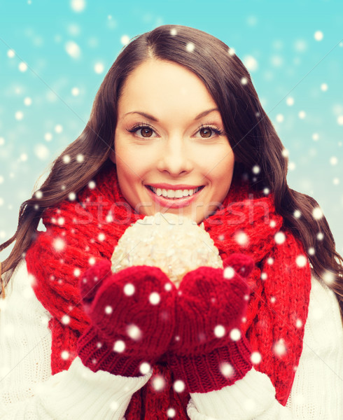 woman in scarf and mittens with christmas ball Stock photo © dolgachov