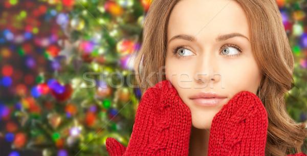 Mutlu genç kadın kırmızı eldiveni ışıklar mutluluk Stok fotoğraf © dolgachov