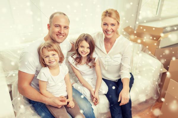 Uśmiechnięty rodziców dwa nowy dom rodziny Zdjęcia stock © dolgachov