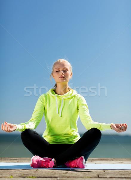 woman doing yoga outdoors Stock photo © dolgachov