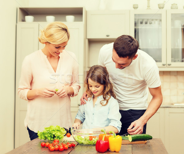 happy family making dinner in kitchen Stock photo © dolgachov