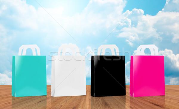 many blank shopping bags Stock photo © dolgachov