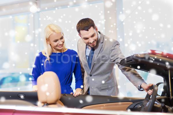 happy couple buying car in auto show or salon Stock photo © dolgachov