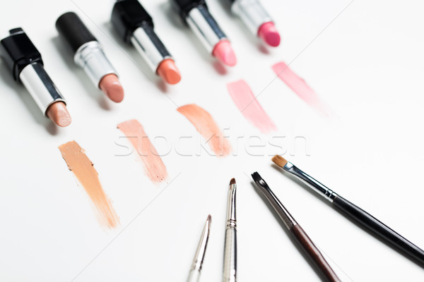 close up of lipsticks range with makeup brushes Stock photo © dolgachov