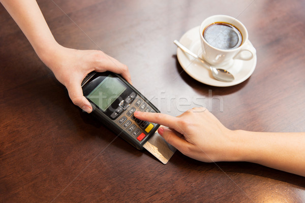 close up of hands with credit card reader at cafe Stock photo © dolgachov